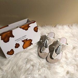 Donald Pliner white/cream snake skin sandals.
